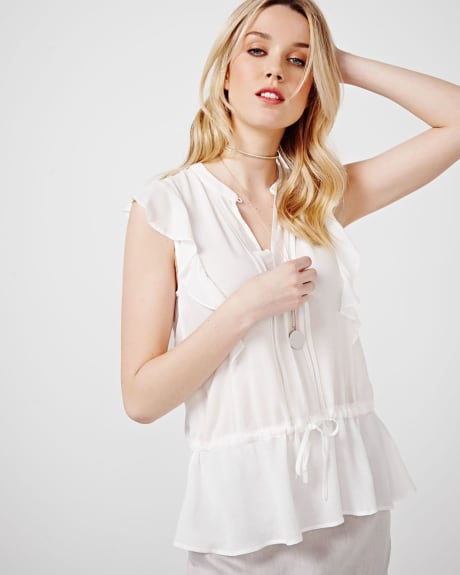 Sleeveless blouse with ruffles and tie