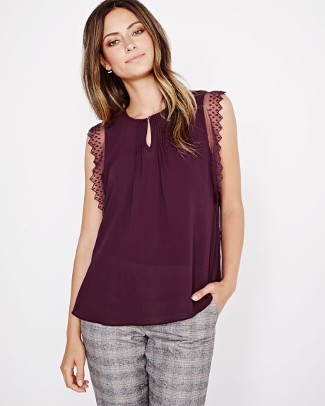Sleeveless blouse with lace trims