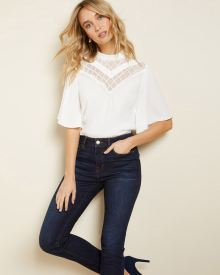 Lace-trimmed mock-neck blouse