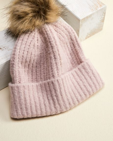 Ribbed pink beanie with faux fur pompom