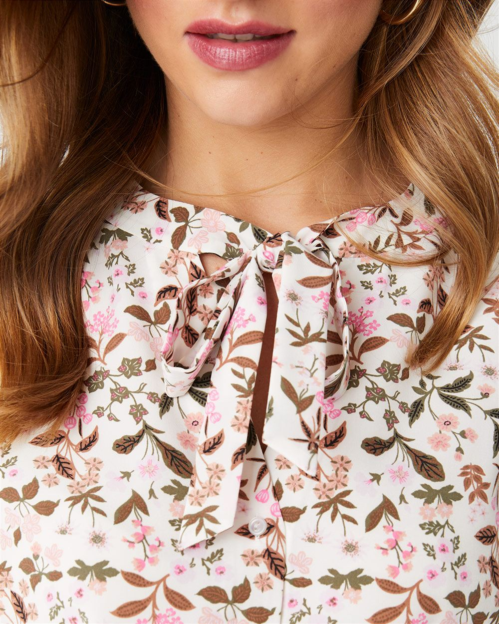 Sleveless button-front blouse with neck bow