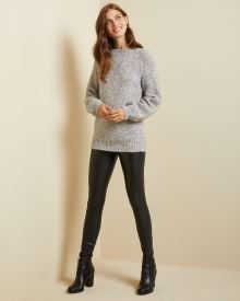 Puffy sleeve mock-neck tunic sweater