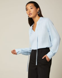 Long sleeve blouse with shirring and neck tie
