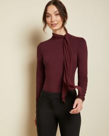 Long sleeve tied mock-neck top