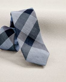 Wide light blue check tie