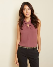 Knotted neck sleeveless blouse