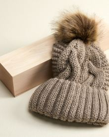 Cable beanie with faux fur pompom