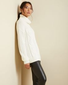 Cable stitch turtleneck sweater