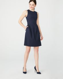 Fit and flare pinstripe city dress with open back