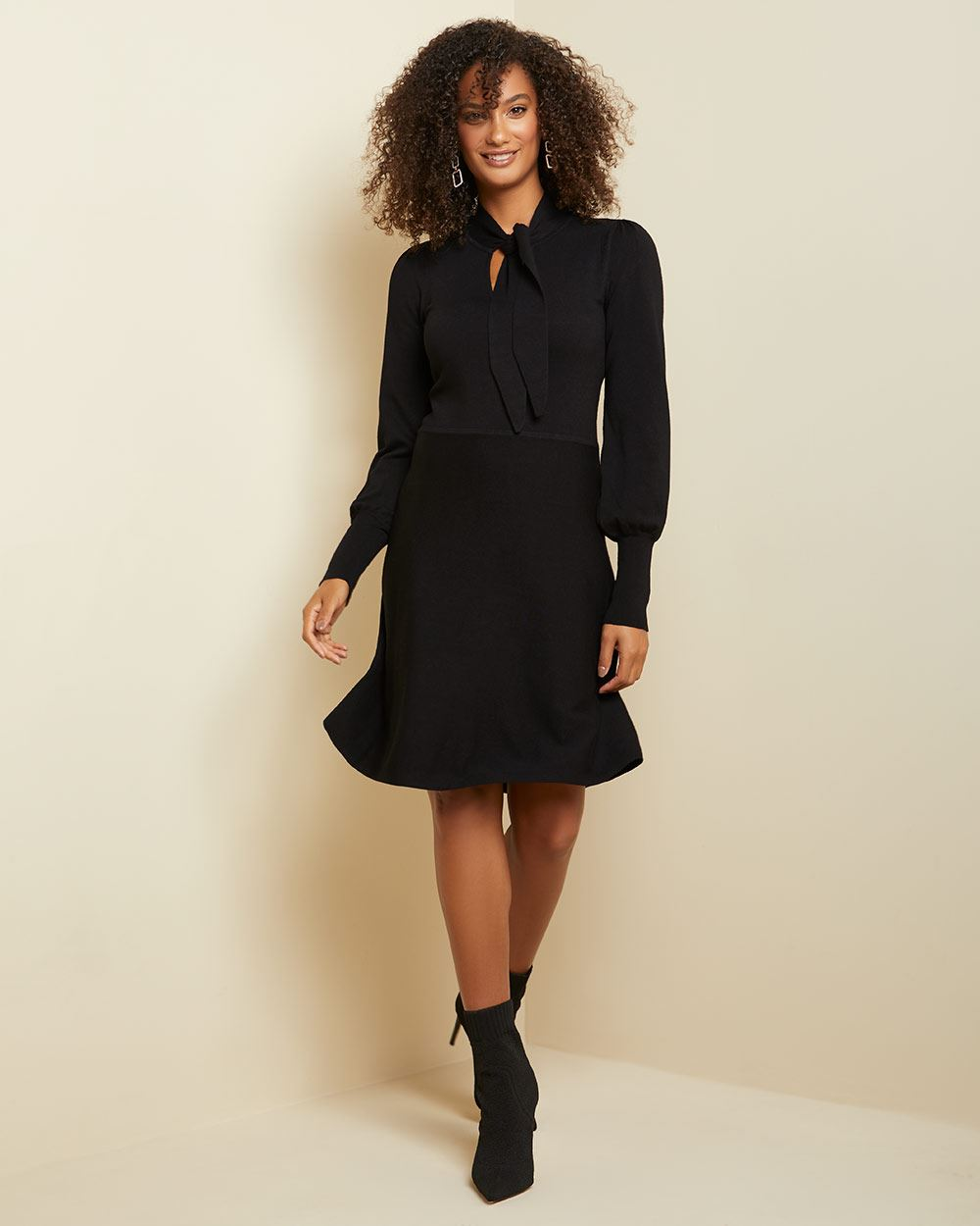 Tied neck fit and flare sweater dress