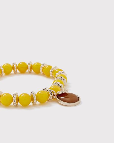 Yellow semi-precious stone bracelet with charm