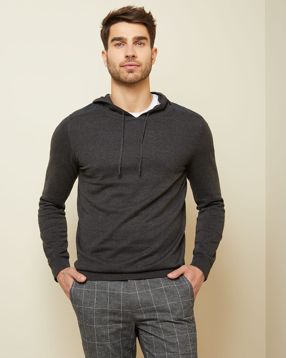 Hooded sweater with shoulder trims