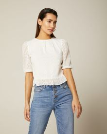 Embroidered lace peplum blouse