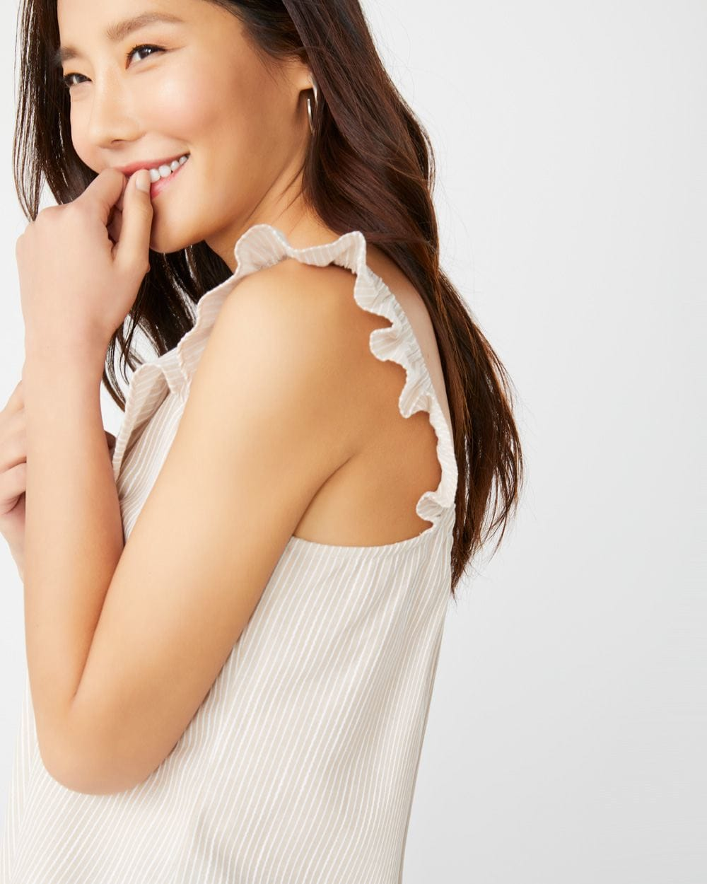 Frilled sleeveless striped blouse