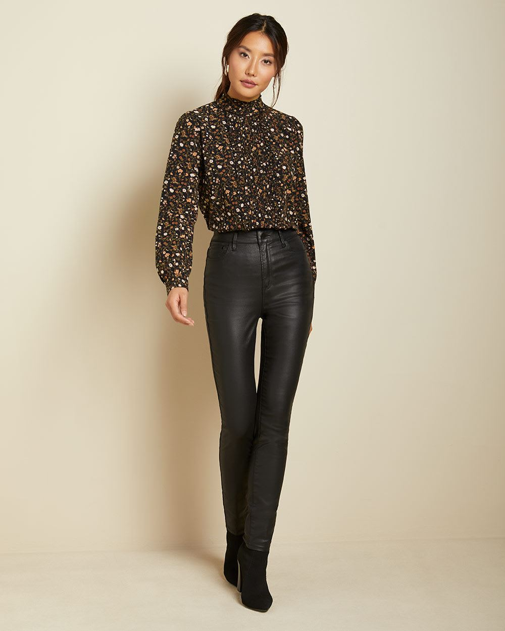 High-waisted coated skinny jeans