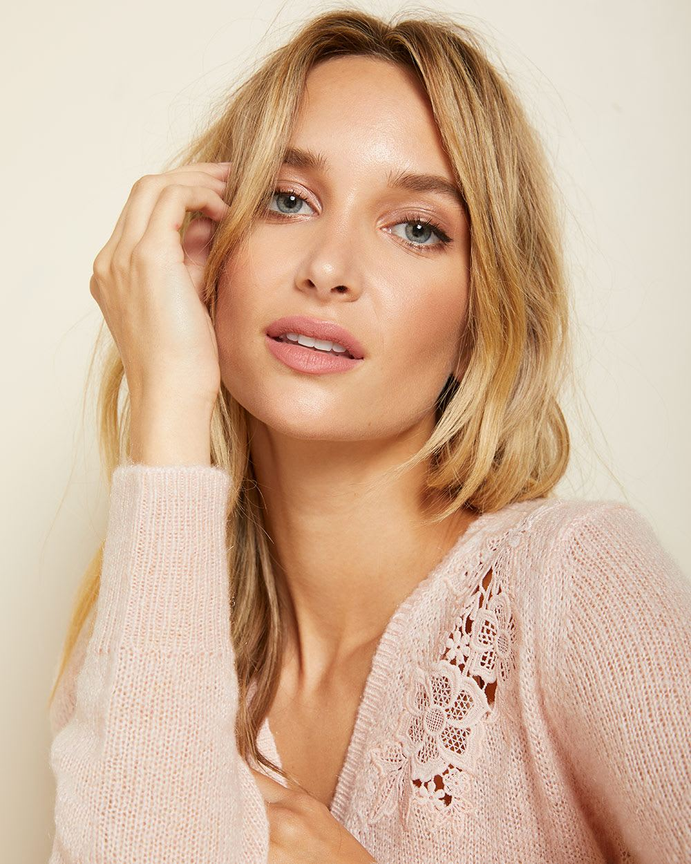 Lace-trimmed crossover sweater