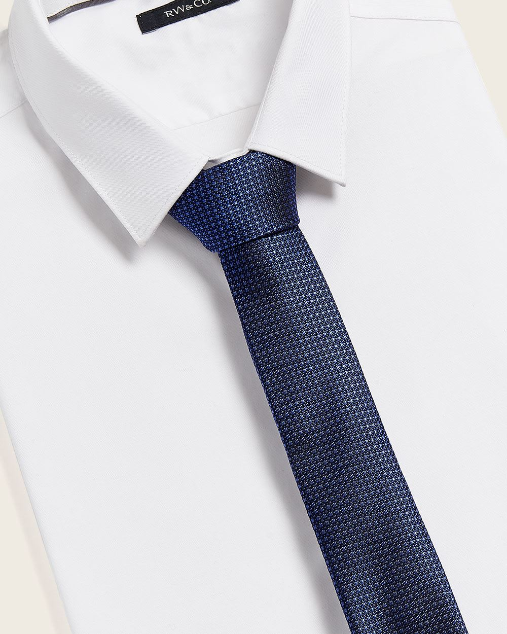 Regular textured blue tone tie