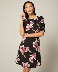 Rushed sleeve fit and flare floral dress