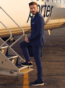 man getting on airplane